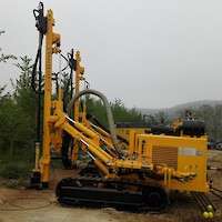 Track-mounted percussion drilling unit
